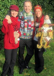 Our Carollers in trio format in our Christmas jumpers